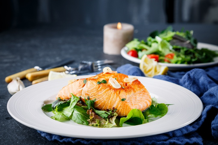 Salmon fish on white plate