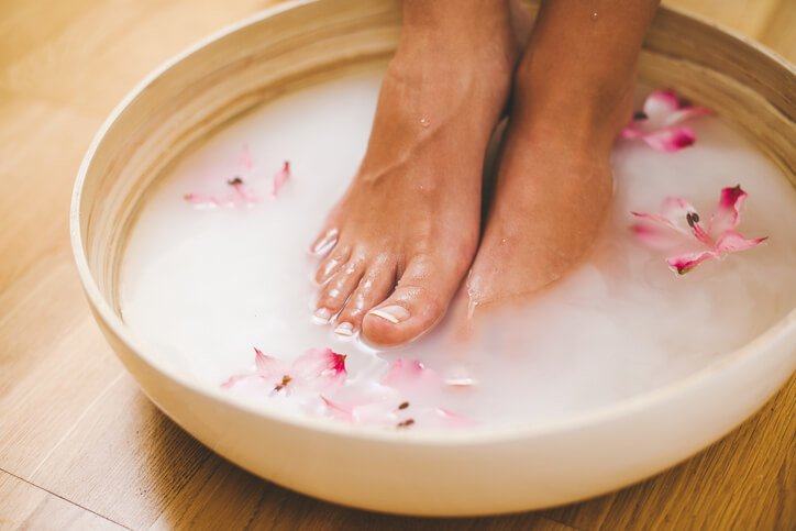 Feet in a foot bath with milk
